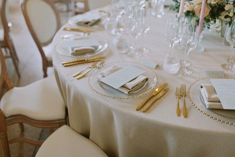 Gold wedding table decor at Kirtlington Park wedding