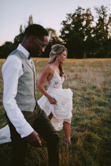 Groom wears grey waistcoat for Kirtlington Park wedding
