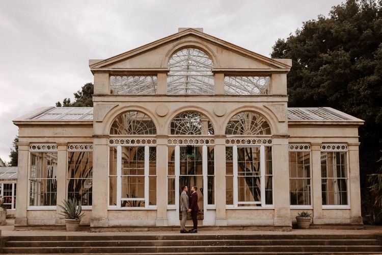 Wedding portrait outside Syon Park conservatory