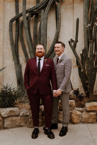 Same sex couple on burgundy and checked suits