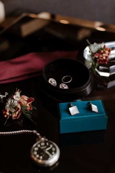 Grooms accessories with cufflinks and wedding band
