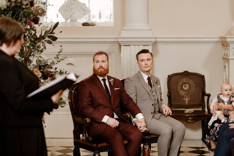 Groom and groom holding hands at Syon Park wedding ceremony