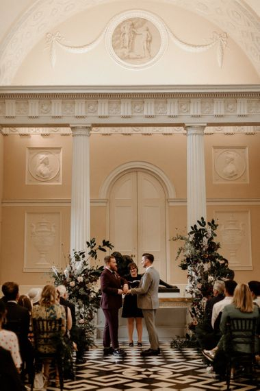 Groom and groom exchanging vows at their Syon Park wedding ceremony