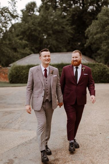 Same sex couple in burgundy and checked suits