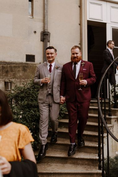 Grooms in burgundy and beige checked suits at Syon Park