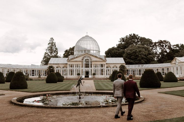 Mr & Mr walking through Syon Park grounds towards the conservatory