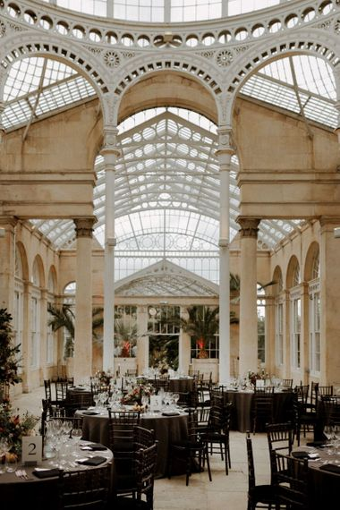 Syon park wedding reception with dark opulent wedding decor and flowers