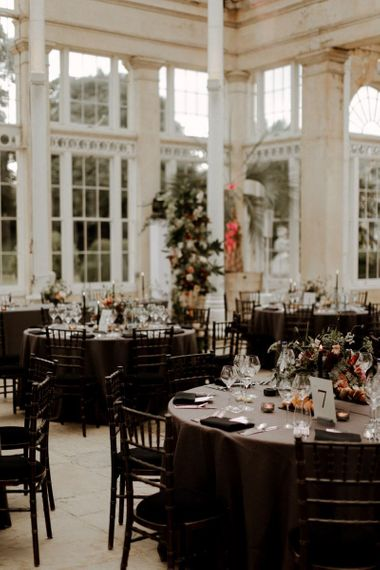 Black wedding reception table cloths and chairs at Syon park wedding