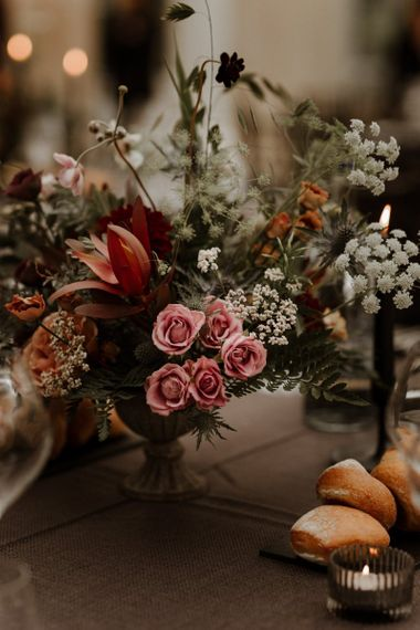 blush pink and orange autumnal wedding flower centrepieces