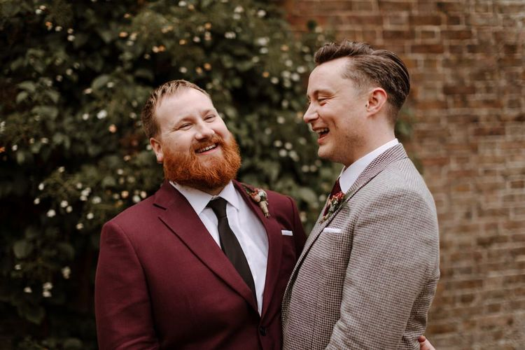 Wedding portrait of groom and groom laughing