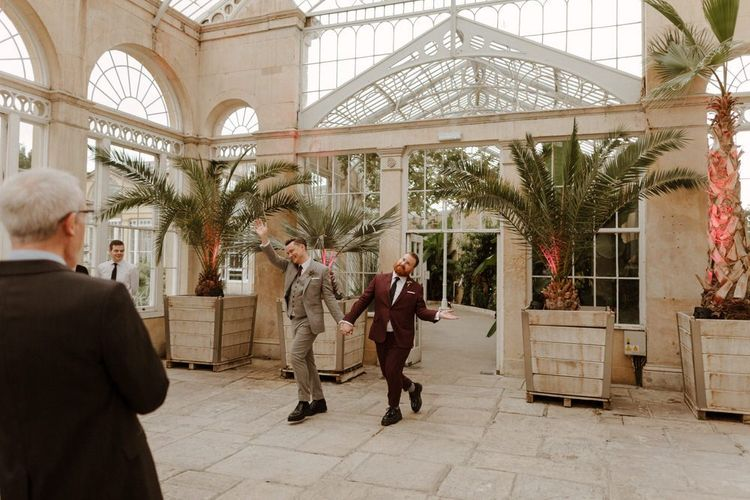 Groom and groom entering the Syon Park wedding reception