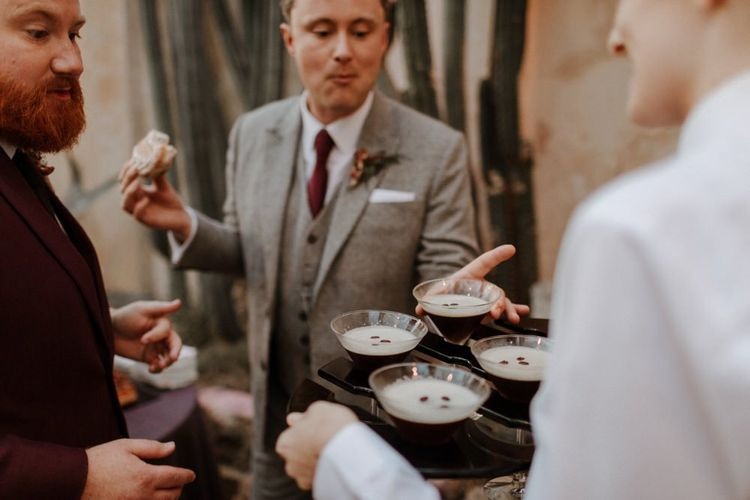 Groom and groom enjoying expresso martini cocktails at Syon Park wedding