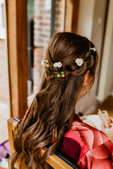 Brides half up half down hair with flowers
