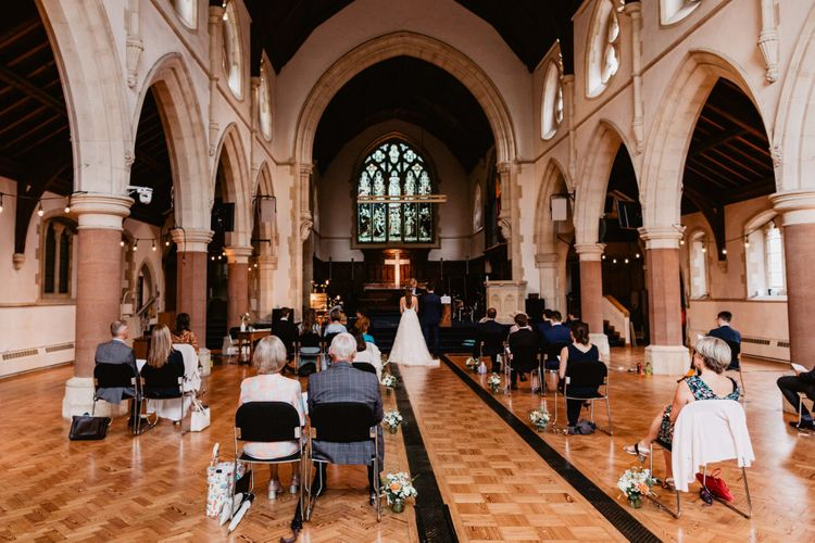 Socially distanced 2020 wedding ceremony in a church