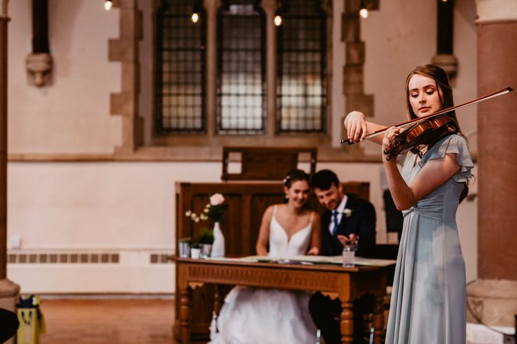 Violin playing whilst the bride and groom sign the register