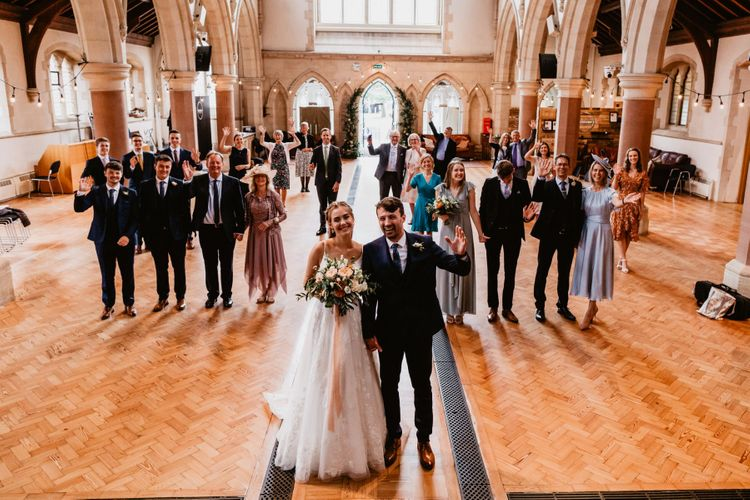 Socially distance wedding guests portrait in the church