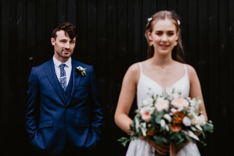 Wedding photography with groom in focus