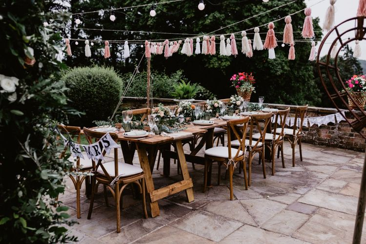 Garden party 2020 wedding reception with tassels and festoon lights