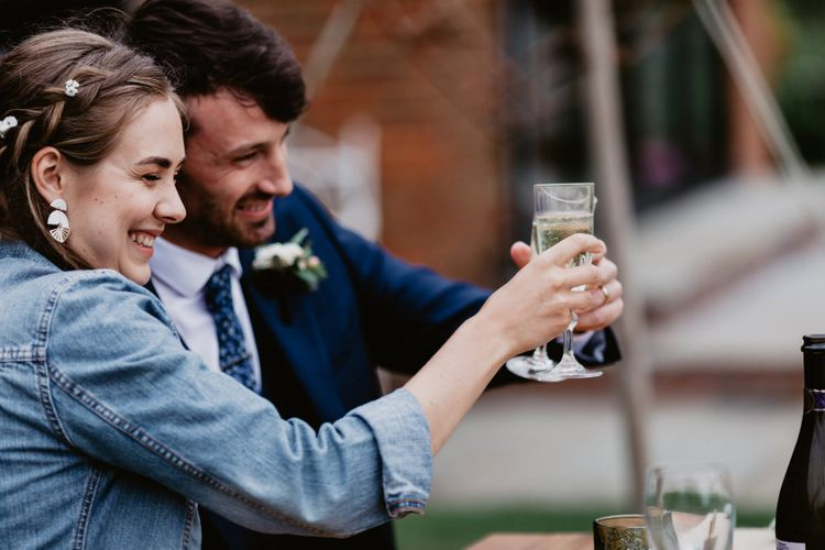 Bride and groom toasting at intimate wedding