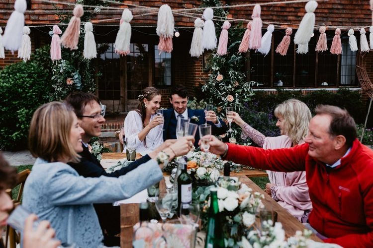 Wedding guests toast at 2020 wedding
