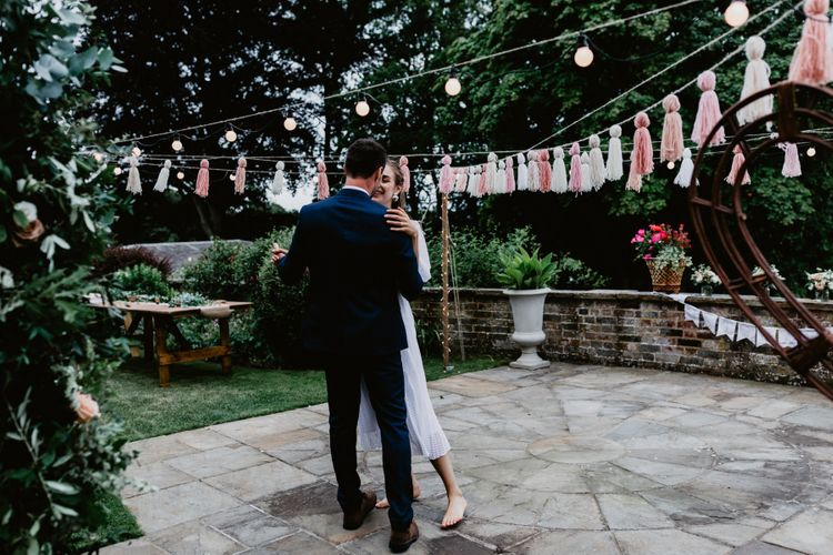 Bride and groom first dance at socially distanced  garden party reception