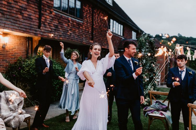 Wedding guests lighting sparklers at 2020 wedding