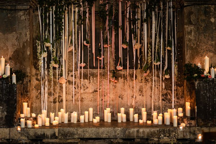 The Asylum Altar with Church Candles and Hanging Ribbon and Flowers