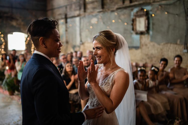 Wedding Ceremony at The Asylum with Bride in Navy Suit and Pink Tie and Excited Bride in Romantic Flora Mila Wedding Dress