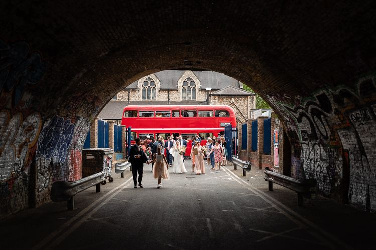 Wedding Guests Getting off the Red Double Decker Bus Wedding Transport