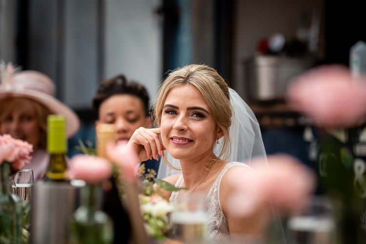 Beautiful Bride Smiling at Wedding Reception Speeches