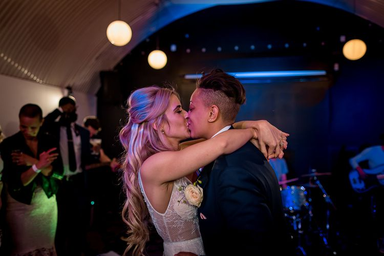 Bride and Bride Kissing on the Dance Floor During First Dance