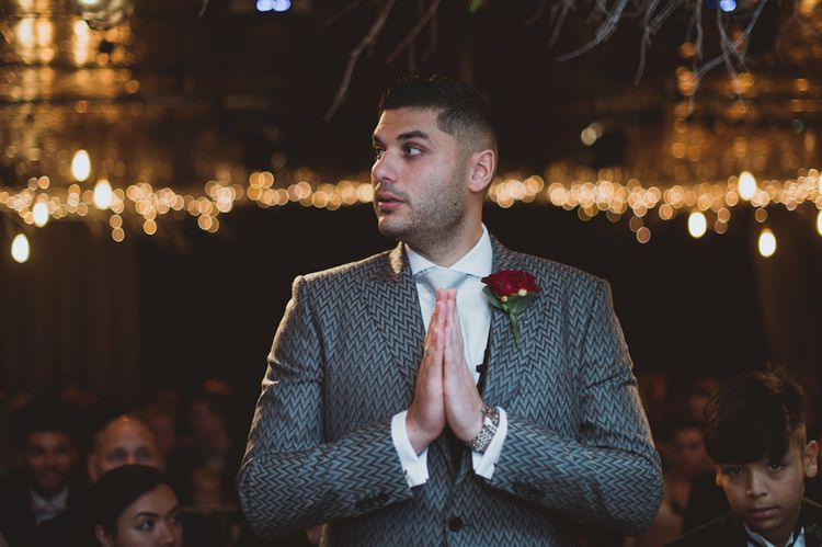 Groom Waits For Bride At Altar Under Fairy Lights