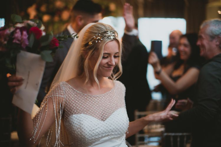 Bride Wears Beaded Wedding Dress