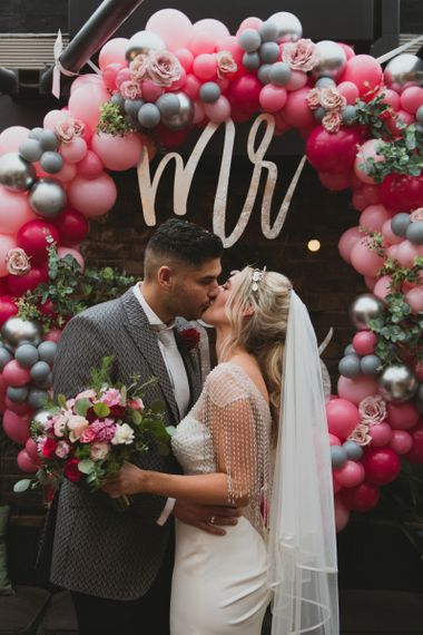 Pink Balloon Wedding Arch and Pink Wedding Flowers