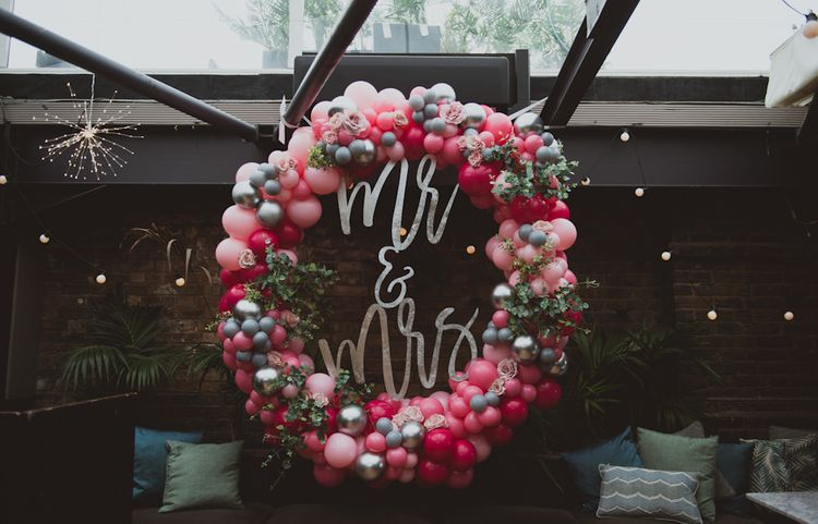 Pink Balloon Arch With Mr & Mrs Sign