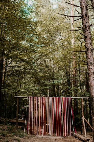 Ribbon Curtain Wedding Decor | Burgundy Outdoor Woodland Ceremony & Country Tipi & Horse Bar Reception at The Ancient Woodland, Hertfordshire, Planned & Styled by Caroline Hitchcock Events | Alex Wysocki Photography | DgtlCouture Film