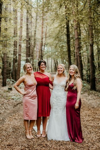 Bridesmaids in Different Shades of Pink, Red & Burgundy | Burgundy Outdoor Woodland Ceremony & Country Tipi & Horse Bar Reception at The Ancient Woodland, Hertfordshire, Planned & Styled by Caroline Hitchcock Events | Alex Wysocki Photography | DgtlCouture Film