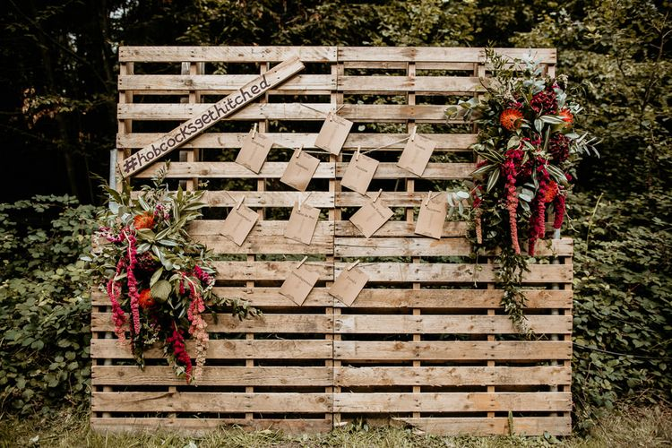 Wooden Palette Table Plan | Burgundy Outdoor Woodland Ceremony & Country Tipi & Horse Bar Reception at The Ancient Woodland, Hertfordshire, Planned & Styled by Caroline Hitchcock Events | Alex Wysocki Photography | DgtlCouture Film