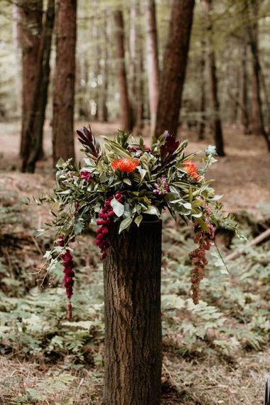 Wedding Floral Arrangement | Burgundy Outdoor Woodland Ceremony & Country Tipi & Horse Bar Reception at The Ancient Woodland, Hertfordshire, Planned & Styled by Caroline Hitchcock Events | Alex Wysocki Photography | DgtlCouture Film