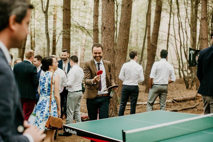 Table Tennis Wedding Garden Games | Burgundy Outdoor Woodland Ceremony & Country Tipi & Horse Bar Reception at The Ancient Woodland, Hertfordshire, Planned & Styled by Caroline Hitchcock Events | Alex Wysocki Photography | DgtlCouture Film