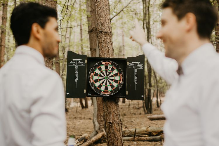 Darts Board Wedding Garden Games | Burgundy Outdoor Woodland Ceremony & Country Tipi & Horse Bar Reception at The Ancient Woodland, Hertfordshire, Planned & Styled by Caroline Hitchcock Events | Alex Wysocki Photography | DgtlCouture Film