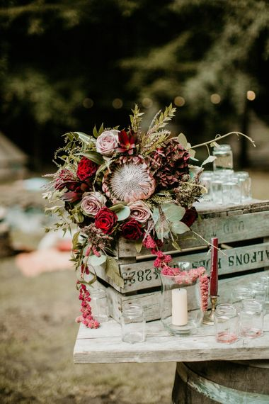 Deep Red & Pink, Rose & Protea Bridal Boquet | Burgundy Outdoor Woodland Ceremony & Country Tipi & Horse Bar Reception at The Ancient Woodland, Hertfordshire, Planned & Styled by Caroline Hitchcock Events | Alex Wysocki Photography | DgtlCouture Film