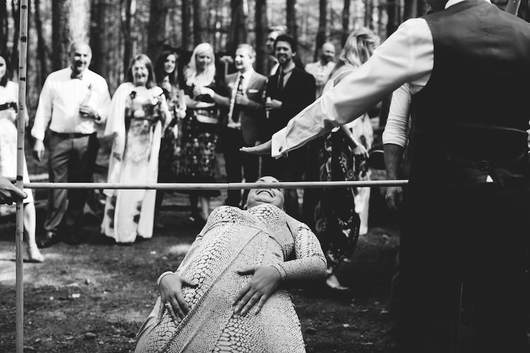 Limbo Wedding Garden Games | Burgundy Outdoor Woodland Ceremony & Country Tipi & Horse Bar Reception at The Ancient Woodland, Hertfordshire, Planned & Styled by Caroline Hitchcock Events | Alex Wysocki Photography | DgtlCouture Film