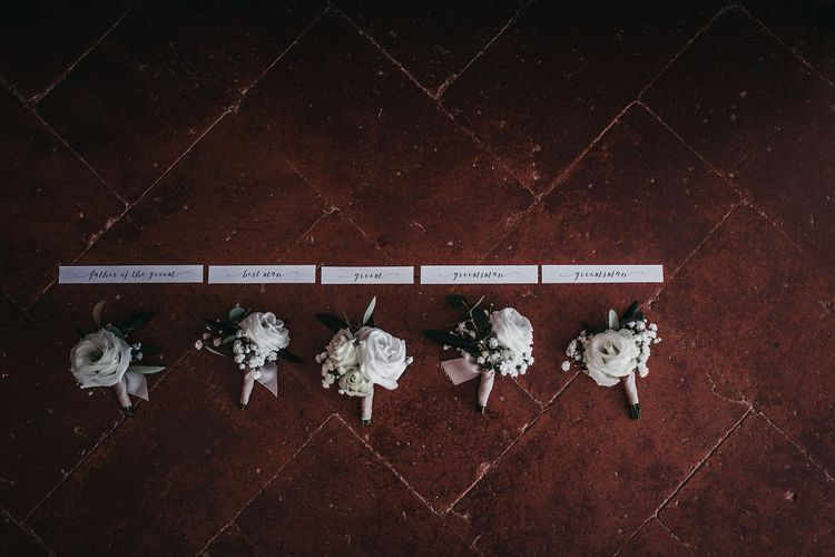 Buttonholes for groom and groomsmen at black and white wedding