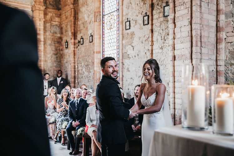 Bride and groom exchange vows in small church in Tuscany