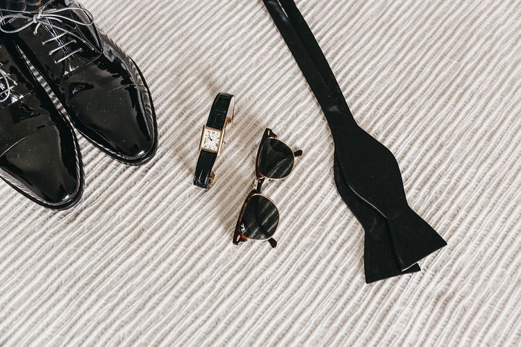 Groom accessories for black and white wedding