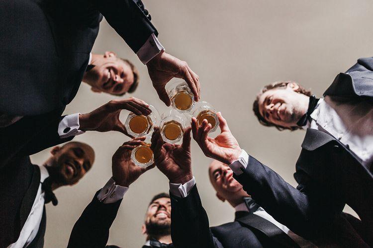 Groom and groomsmen make a toast