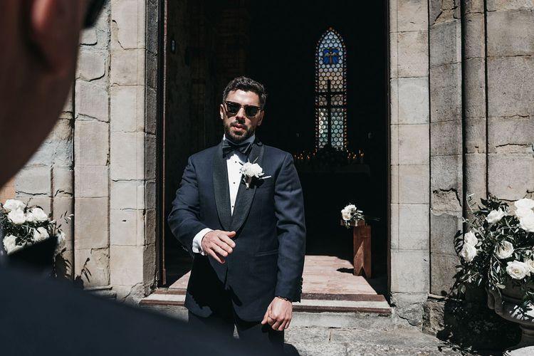 Groom in tuxedo for black and white wedding