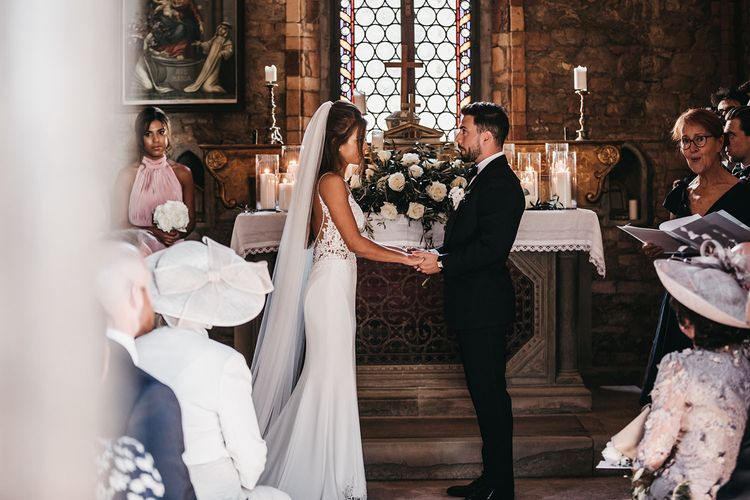 Bride and groom say I do in church