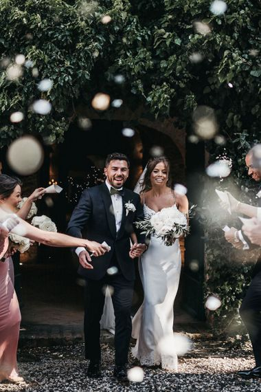 Confetti exit for couple in Tuscany